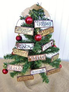 Handmade Paint-Stick Ornaments HGTV.  Would be great to go in the Christmas Baskets with a Christmas Scripture or quote on it.