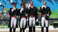 (L-R) Fiona Bigwood, Charlotte Dujardin, Carl Hester and Spencer Wilton receive their silver medals