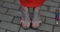 Ghettoes!! look at those things eekkk! At least put some polish on those talons lol.. Not trying to be mean but some people should not wear shoes like that are too small....