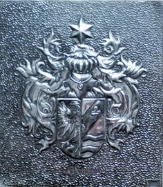 Embossed pewter family crest