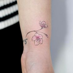 Cherry blossoms on wrist by Tattooist Doy