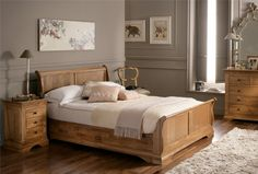 in pine... with some built in storage... and a bit higher head board with some more curve... a little more distressed... love old sleigh beds :-)