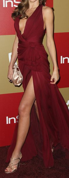 Zuhair Muard wine coloured gown with deep plunge, thigh high slit and ruffle detail at the waist