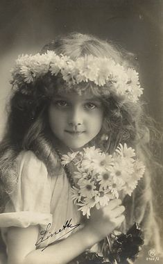 girl with daisies. (fiction) Valerie Jean Barwick - age 7 - Valerie's mother