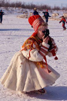 sami women of norway   ... : Sami woman in traditional costume takes photos. Kautokeino. Norway