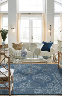 Offering an inviting color palette with a splash of sun washed hues-this design is suited to pair beautifully in a modern or classic home! #blue #vintage