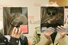 Chris Lowe (L) and Neil Tennant of British pop band 'Pet Shop Boys' joke as they present a book with pictures of their group and coverdesigns, 07 May 2007 at a bookshop in Berlin.