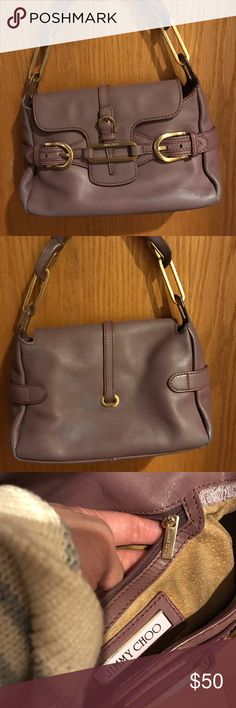 Jimmy Choo Handbag Small size. 100% authentic. Has slight discoloration on the exterior and suede interior is discolored. Price reflects flaws! Jimmy Choo Bags
