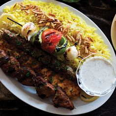 Shish Taouk (Spiced Chicken Kebabs with Garlic Yogurt Sauce) Recipe - Saveur.com Any recipe where the first ingredient listed is 10 cloves of garlic had to be good!