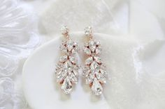 Few elements are as glamorous and as elegant as Swarovski crystals, so if you are searching for a budget-friendly option for your wedding day accessories, this breath-taking pair of vintage style Swarovski crystal bridal earrings with white opal is exactly what you need. Just perfect for a glamorous bride!