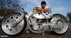 US custom bike designer Rafik Kaissi poses next to a Buell custom made motorbike for pictures during a press presentation on November 15, 2013 at the fair grounds in Essen, western Germany. The motor...