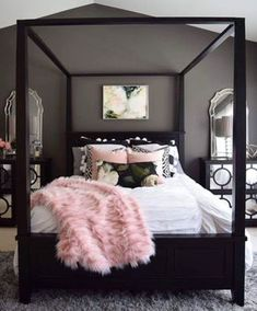 Absolutely love this bedroom. From the dark grey walls, the black bed frame/posts, the plain color scheme with a pop of baby pink to add color.