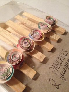 Check out my friends Etsy shop: all profit goes towards their adoption from Ethiopia Set of 6 paper flower clothespin magnet by PancakesandGlueGuns, $7.00