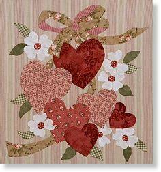 Another stunning appliqué piece. I believe those could be dogwood blooms and aren't they just exquisite? Thank you for sharing your wonderful talents crafters!