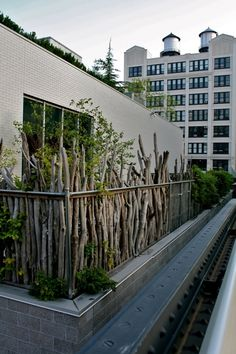 "Patio ""railing"" or garden fence... perfect recycling of pruning twigs or branches."