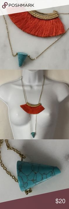 Bohemian Necklaces Long turquoise cone necklace, which has a slight chip on the bottom as pictured. And a orange fringe short necklace. Both are gold tone. See pictures for measurements. Jewelry Necklaces