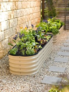 If space is an issue the answer is to use garden boxes. In this article we will show you how all about making raised garden boxes the easy way. We all want to make our gardens look beautiful and more appealing. Metal Garden Beds, Garden Boxes, Sloped Garden, Trough Planters, Garden Planters, Indoor Garden, Outdoor Planters, Indoor Outdoor, Raised Vegetable Gardens