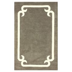 Wool-blend rug in taupe with a contrast frame motif. Hand-tufted in India.   Product: RugConstruction Material: ...