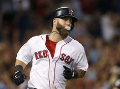 Boston Red Sox's Mike Napoli blows a bubble as he rounds first after hitting a solo home run against the Tampa Bay Rays during the seventh inning of a baseball game at Fenway Park in Boston Wednesday, July 24, 2013. (AP Photo/Elise Amendola)