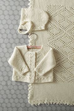 Heirloom Layette- Blanket Bonnet Sweater Pattern [ Heirloom Layette- Blanket Bonnet Sweater by Kerin Dimeler- Laurence, Spring is the celebration of lifeThis hat, sweater, and blanket set is a true treat for any new baby. A bit of lace and easy shapi Sweater Knitting Patterns, Knit Patterns, Cardigan Bebe, Baby Cardigan, Hooded Sweater, Baby Layette, Baby Pullover, Knit Picks, Knitting For Kids