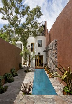 Nestled into the quiet middle of a block in the historic center of the beautiful colonial town of San Miguel de Allende, this 4,500 square foot courtyard home is accessed through lush gardens with trickling fountains and a luminous lap-pool.  The livi