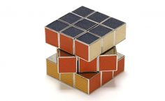 Our handmade, solid chrome Rubik's Cube® is accented with vibrant leather-inlaid sides that provide poise to every pivot.  $295