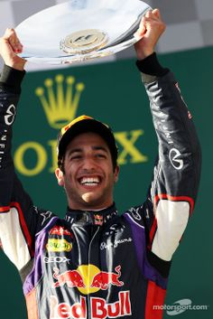 Daniel Ricciardo celebrating on the podium - 2014 Australian GP. Unfortunately he was disqualified not long after.