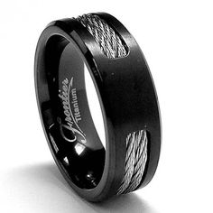 This unique wedding band for him caught our eye with its braided detailing and black carbon look.