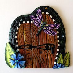 Her work inspires me: Dragonfly Fairy Door by Claybykim on Etsy