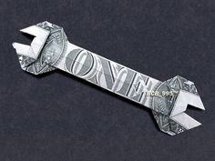Hello, Up for sale is a beautifully crafted origami Wrench. It's made with a brand new dollar bill. To see a video of this item before ordering, please go to: https://www.youtube.com/watch?v=o46adwU3L8o It makes a great novel gift for that special someone in your life! Perfect for: Birthdays, Gradations, Holidays, add to your dinner tips, place them in gift baskets, etc... And during Christmas, they make perfect stocking stuffers! Thanks for checking out my listing...