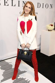 In an Elsa Schiaparelli couture jacket, top and shorts and red sued over-the-knee boots while promoting her new bag line in Las Vegas.