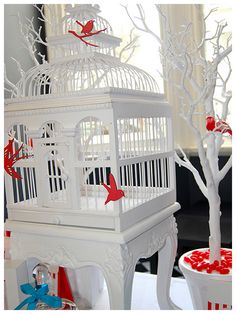 I just like the laser cut red bird at the top of the cage and the use of branches. Decorated Bird Cage