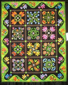 applique quilt based on blocks by Piece O'Cake designs