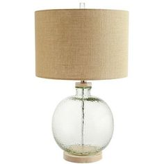 The classic design of our hammered recycled glass lamp is influenced by coastal decor. Sitting pretty atop a natural pine base and finished with a burlap shade, it features a three-way switch for lighting your space just the way you want.