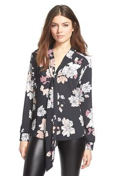 Free shipping and returns on ASTR Tie Neck Button Front Blouse at Nordstrom.com. Draping neck ties put a retrospin on an airy chiffon blouse patterned in a pen-and-ink-inspired floral print.