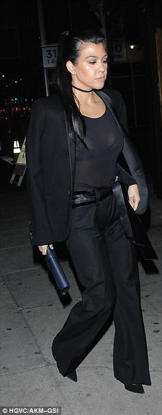 It looked as though black was the recurring colour of the evening, as Kourtney, 36, and Ke...