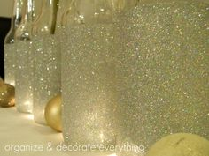 Gorgeous glitter bottles  ~ add fairy lights by drilling holes before glittering ~   http://organizeyourstuffnow.com/wordpress/?p=26006