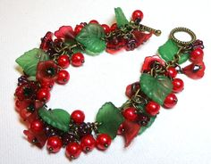 Jewelry Bracelet Red Green Glass Pearl Lucite Flowers Czech Glass Leaf Swarovski Emerald Crystals Antique Brass FREE SHIPPING. $20.00, via Etsy.