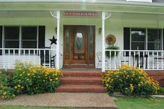 How adorable is this welcoming front porch at 1423 Durham Springs Rd in Scottsville, KY?
