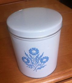 """A great vintage 60's metal canister, made to """"go-with"""" the Corning Cornflower pattern. The canister measures approximately 5"""" high. (cost: 12.00)"""