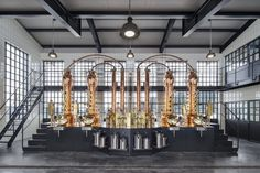 Like the gin its known for, the design of the Monkey 47 Distillery in Germany channels the spirit of the surrounding Black Forest. Cocktails Made With Gin, Distilling Equipment, Beer Factory, Brewery Design, Gin Distillery, Steel Windows, Top Interior Designers, Design Language, Design Firms