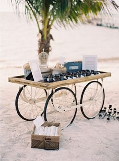 Rustic beach wedding favors displayed on our carreta by Haring Photography