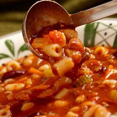 Olive Garden's Pasta e Fagioli (Italian Chili) - CopyCat Recipe!    Ingredients:  1 lb. ground beef  1 small onion, diced (1 cup)  1 large carrot, julienned (1 cup)  3 stalks celery,  chopped (1 cup)  2 cloves garlic, minced  2 - 14.5 oz. cans diced tomatoes  1 - 15 oz. can red kidney beans (with liquid)  1 - 15 oz. can great nothern beans (with liquid)  1 - 15 oz. can tomato sauce  1 - 12 oz. can V-8 juice  1 tbsp. white vinegar  1 1/2 tsp. salt  1 tsp. oregano  1/2 tsp. pepper  1/2 tsp. thyme  1/2 lb. (1/2 package) ditali pasta    Instructions:  1. Brown ground beef in large pot over medium heat; drain off fat.  2. Add onion, carrot,  celery, and garlic; saute approx. 10 minutes.  3. Add remaining ingredients except pasta and simmer 1 hour.   4. About 50 minutes into simmer, cook pasta in 2 quarts boiling water over high heat. Cook 10 minutes or until pasta is al dente. Drain.   5. Add pasta to pot of soup. Simmer 5-10 minutes and serve.  ** Serves 8.