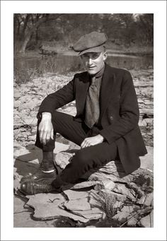 U.S. A man sitting by a river, 1920s / Flickr by Steve Given