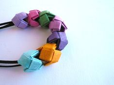 Spring jewelry- Colored paper necklace- Origami jewelry- Spring blossoms Must learn how to make these myself! Origami Jewels, Origami Necklace, Origami And Quilling, Paper Crafts Origami, Origami Art, Paper Earrings, Paper Jewelry, Fabric Jewelry, Jewelry Crafts