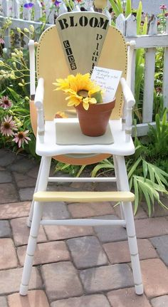Repurposed vintage high chair...Dual use.. toddler seat or plant stand...Says...BLOOM plants kids...  Now available at the Memory Furniture Booth at Black Diamond.