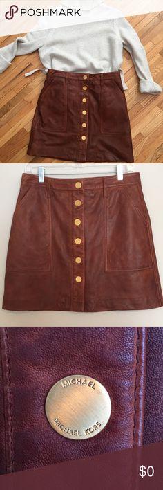 Michael Kors Leather Buttoned A-Line Mini Skirt Worn Once  Michael Kors lambskin leather a-line skirt in Cognac.   Size 8. MICHAEL Michael Kors Skirts Mini