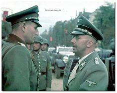 Reichsfuhrer Heinrich Luitpold Himmler chats to a General.