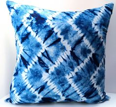 INDIGO CHEVRON CUSHION COVER  For the interior designer and decorator in us all: add this unique, hand-dyed cushion cover to your home, as the perfect complement to boho chic decor.  Indigo Chevron is skillfully dyed in the traditional tie-dye method, resulting in this exquisite pattern, in beautiful shades of indigo blue. The fabric, 100% cotton, is naturally dyed using plant-derived indigo. The reverse fabric is an organic cotton, hemp blend.  Your super comfortable and long wearing…