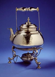 This is the earliest known English silver tea-kettle, marked 1694-5. It is engraved with the coat-of-arms of the Norfolk Buxton family, although made in London.